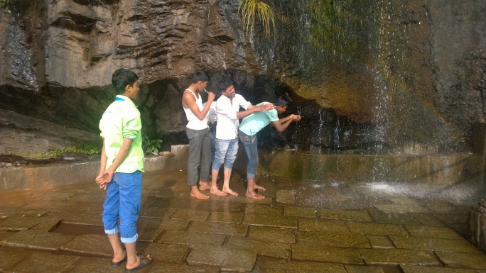 Adarsh balak(ideal boy) forgot to brush their teeth before coming to temple, so they did in temple :)