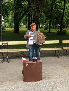 Street artist singing and playing in Warsaw, poland
