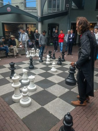 People smoking joint and playing Chess on street of Amsterdam Netherland