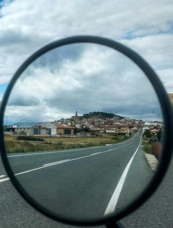 small village in Spain through the mirror of Honda transalp motorcycle