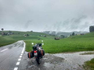 Crossing small villages in Switzerland on a a Honda Transalp motorcycle