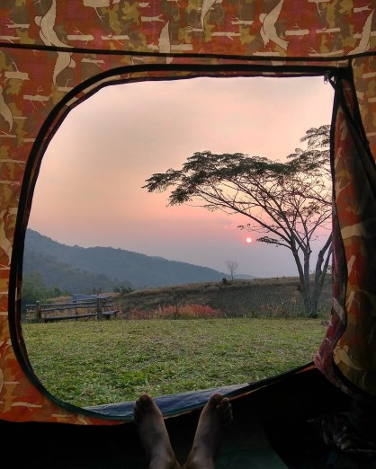 sunrise view from tent in Phutoei National Park, Thailand